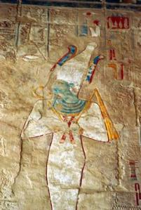 Osiris (Un Nefer) with BLUE FEATHERS on his head surrounding WHITE CROWN HAT  (Symbol of his raise to KING OF HEAVEN)