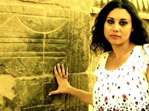 Susan Elsa touching original IsIs Philae Temple walls where the Ankh (Key of Life) is for magical Focus purposes ©