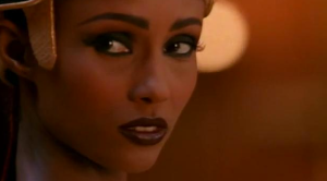 Iman as Nefertiti, bored until Michael entertains her...