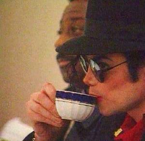 Michael Jackson drinking Tea, watching totally relaxed...