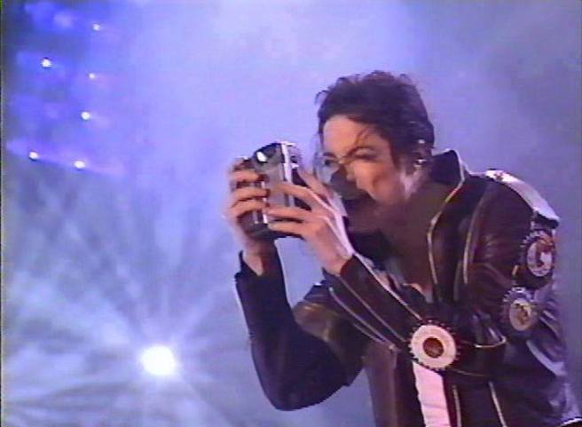 Michael Jackson brings Focus from his Experiences onto the Audience for Healing PHOTO FOR EDUCATIONAL PURPOSE FROM HISTORY TOUR LIVE STAGE
