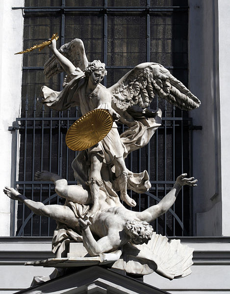 Sculpture of archangel Michael above the entrance of the Michaelerkirche in Vienna.