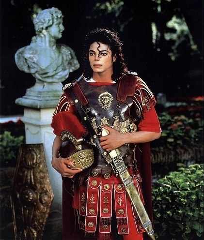 Michael Jackson posing with Sword in typical Archangel Michael Look © Michael Jackson TwinFlame Soul Official